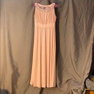 Full length, light pink dress.
